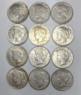 12 Circulated Peace Dollars mixed dates and grades